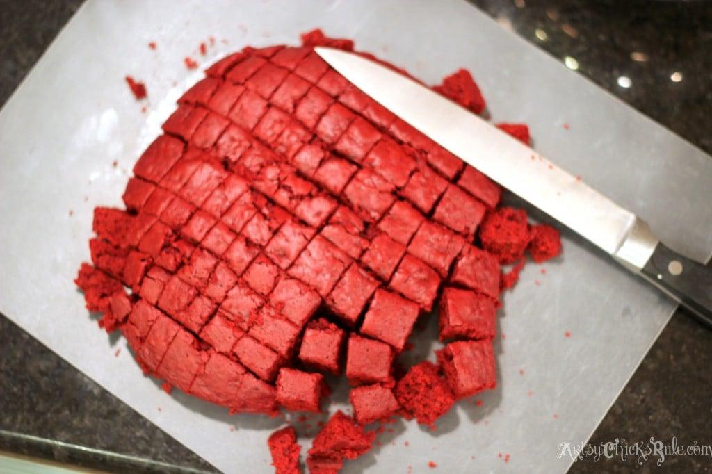 Cutting Red Velvet Cake into Small Squares- #redvelvet arstychicksrule.com BEST dessert!! So easy, love this Red Velvet Trifle!! artsychicksrule.com #redvelvet #redvelvetcake #redvelvettrifle