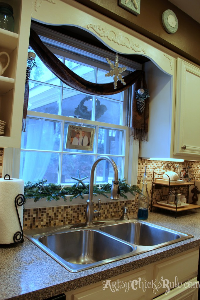 Kitchen window decorated for Christmas - Holiday Home Tour