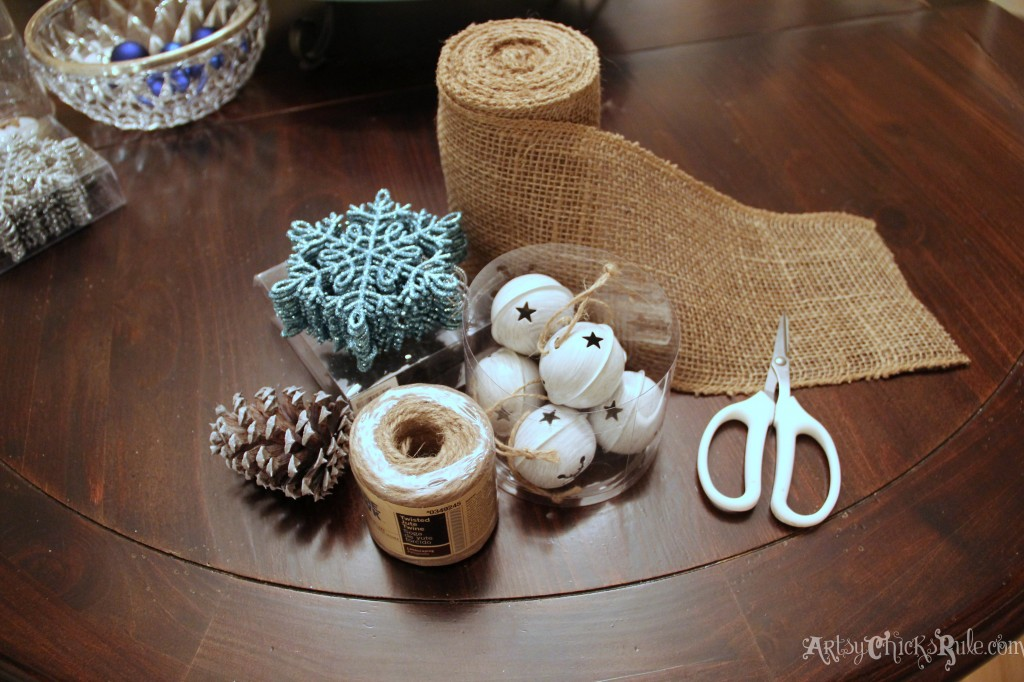 Ornaments, jingle bells, twine, burlap and pine cones for chair decor