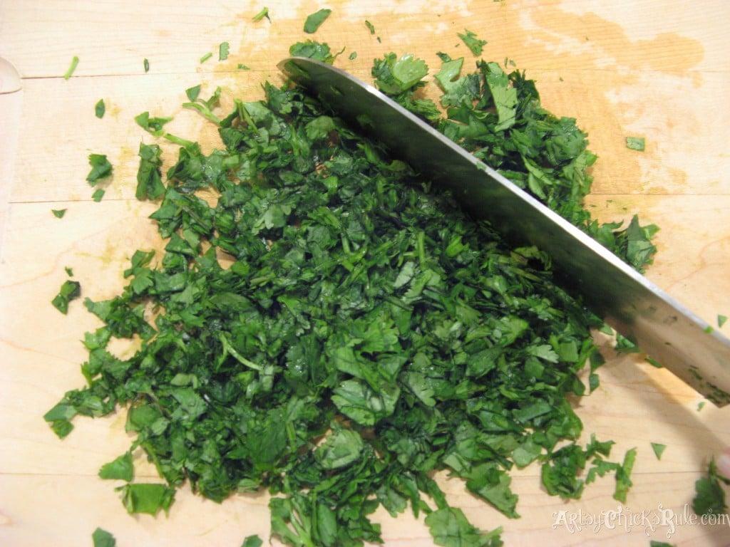 Chopping cilantro for Quinoa Black BeanDip