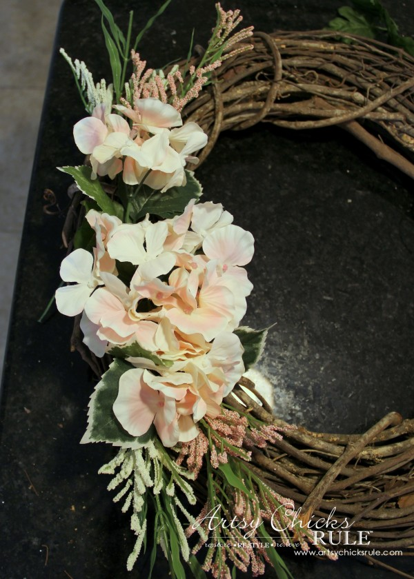 Easy DIY Floral Wreath - Adding as I go using leftover sprigs #wreath artsychicksrule.com