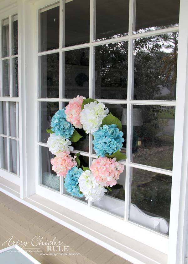 DIY Hydrangea Wreath - on large picture window - DIY Hydrangea Wreath - Colorful Spring Wreath - artsychicksrule.com #hydrangeawreath #springwreath
