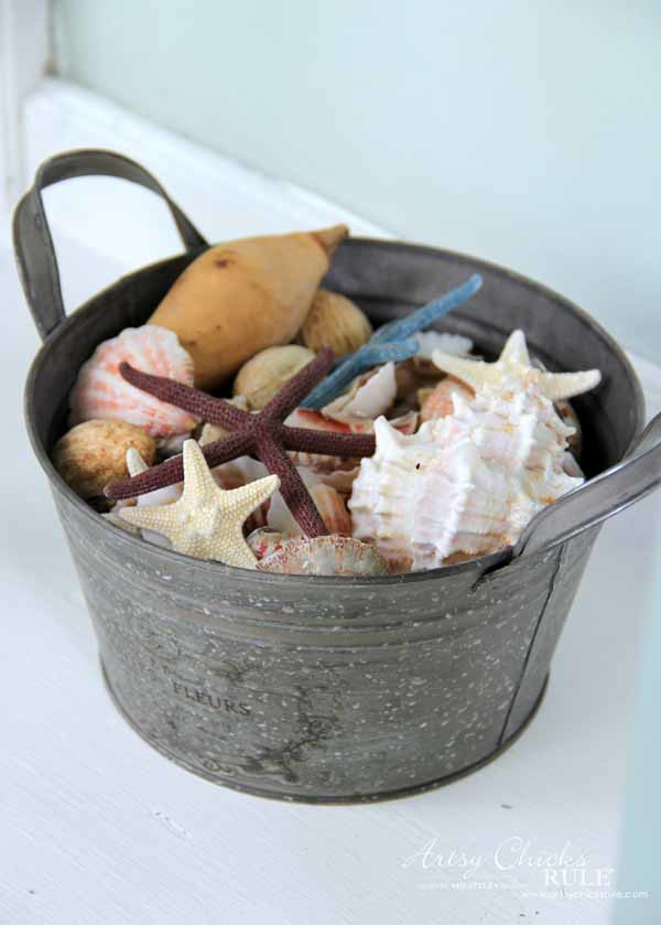 Thrifty Porch Decor - Pail with Seashells - artsychicksrule.com #frontporchdecor