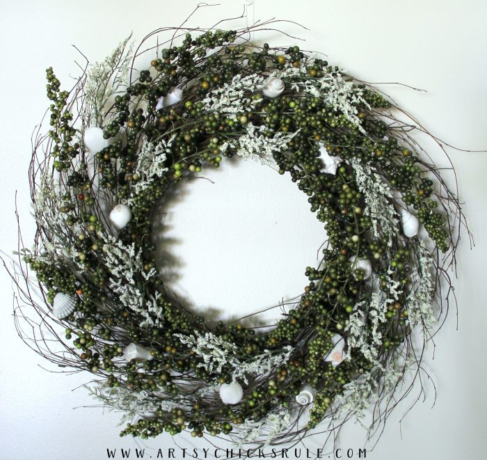 front view of wreath on white wall