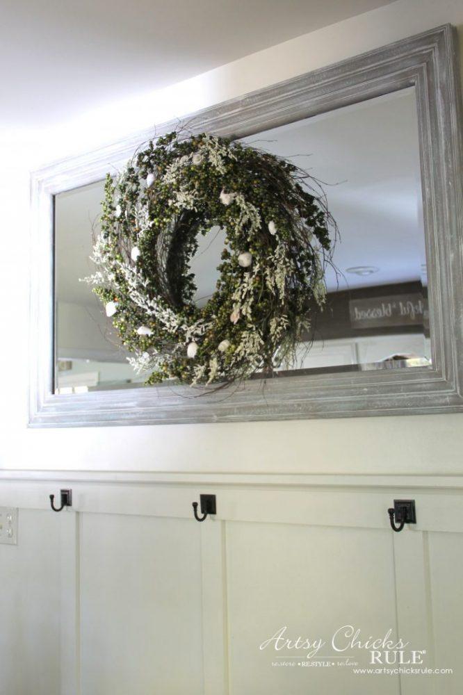 wreath hanging on mirror in kitchen