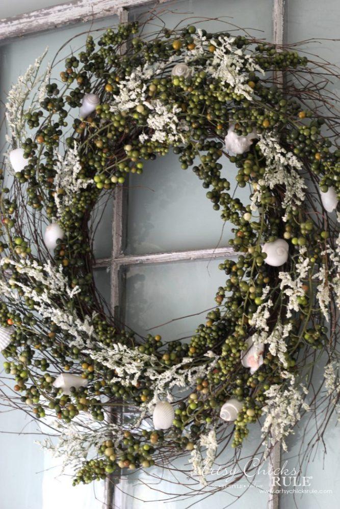 green berry wreath on old window