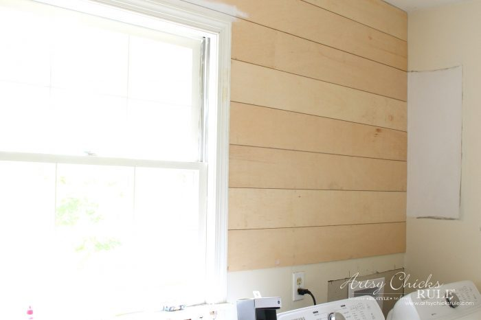 DIY Faux Shiplap - applying boards - artsychicksrule.com #diyfauxshiplap #howtoshiplap #shiplaptutorial #farmhouseshiplap #farmhousestyle #fixerupperstyle #easyshiplap #diyshiplap