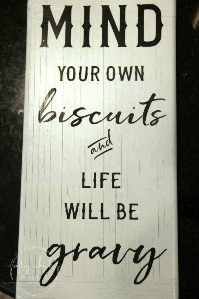 DIY Funny Kitchen Sign & FREE Printable! artsychicksrule.com #freeprintable #funnykitchensign #funnysayings #diysign #silhouettecameo #cutesayings #mindyourownbiscuits #sillysigns