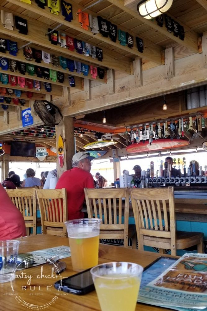 Outer Banks Places To Eat (and shop!) Fish Head's Bar- artsychicksrule.com #outerbanks #outerbankseats #outerbanksshopping #beachdecor #coastalstyle #traveldestinations #travelideas #obx #beachtrips #coastaldestinations