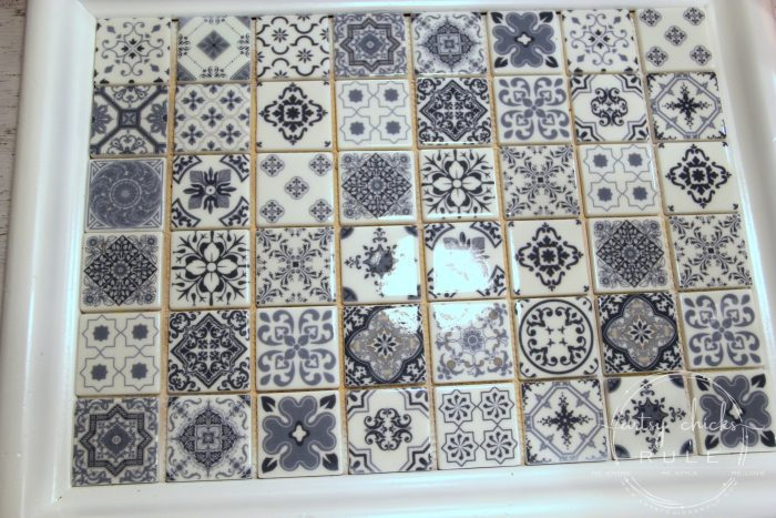 DIY Navy Blue and White Tile Tray....From Thrift Store Find! (add grout) artsychicksrule.com #blueandwhitetile #blueandwhitedecor #tileideas #thriftymakeover #trashtotreasure #blueandwhite #blueandwhitepillows