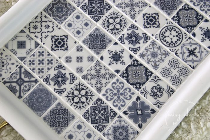 DIY Navy Blue and White Tile Tray....From Thrift Store Find! artsychicksrule.com #blueandwhitetile #blueandwhitedecor #tileideas #thriftymakeover #trashtotreasure #blueandwhite #blueandwhitepillows