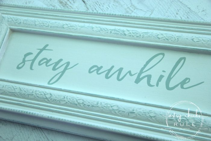Make Your Own Stay Awhile Sign With This FREE Printable spray paint and done! artsychicksrule.com #repurposed #cabinetdoorideas #stayawhile #diysign #freeprintable #cabinetdoorrepurposed #silhouetteprojects