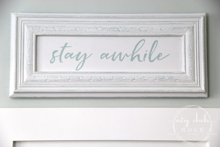 Make Your Own Stay Awhile Sign With This FREE Printable (on wall) artsychicksrule.com #repurposed #cabinetdoorideas #stayawhile #diysign #freeprintable #cabinetdoorrepurposed #silhouetteprojects