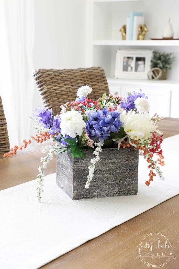 Simple Spring Floral Arrangement - Using an old thrift store find! artsychicksrule.com #springfloralarrangement #springflowers #flowerarrangement #springdecorideas #springdecor