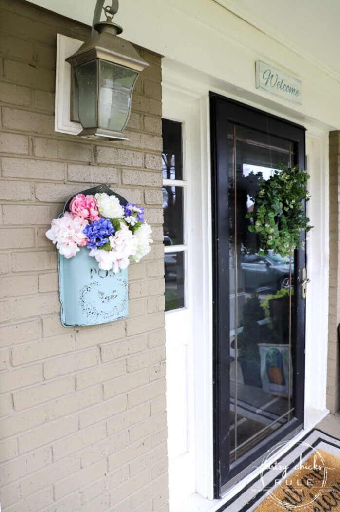 This sweet antique mailbox makes the perfect spot for spring flowers!! Even if it's the wrong color! Just paint it! artsychicksrule.com front door eucalyptus wreath