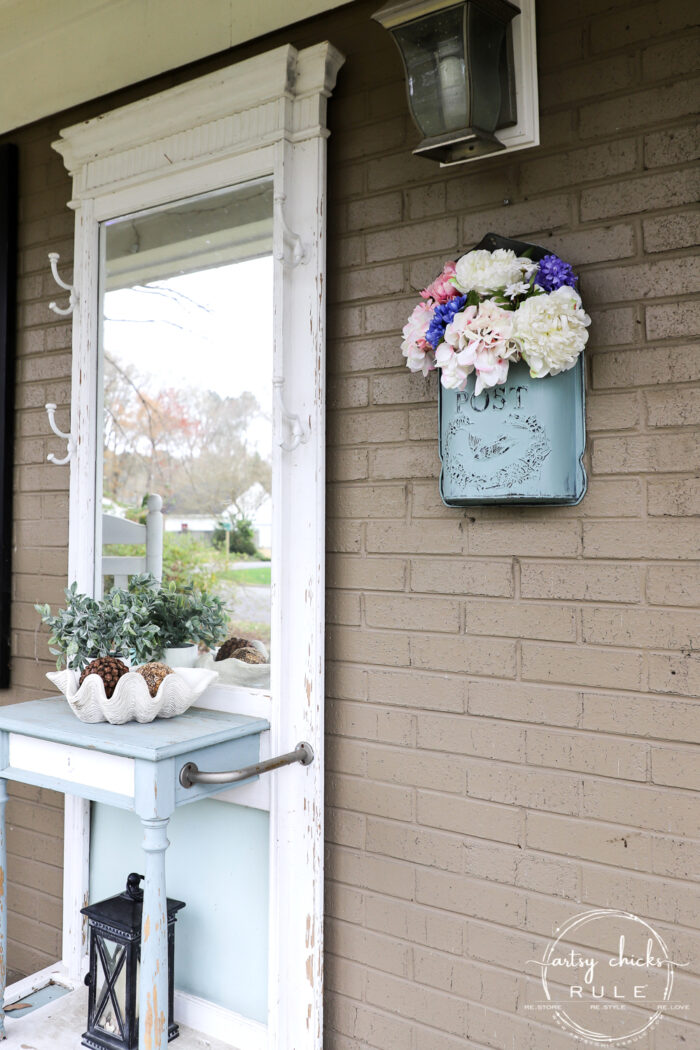 This sweet antique mailbox makes the perfect spot for spring flowers!! Even if it's the wrong color! Just paint it! hall tree on porch