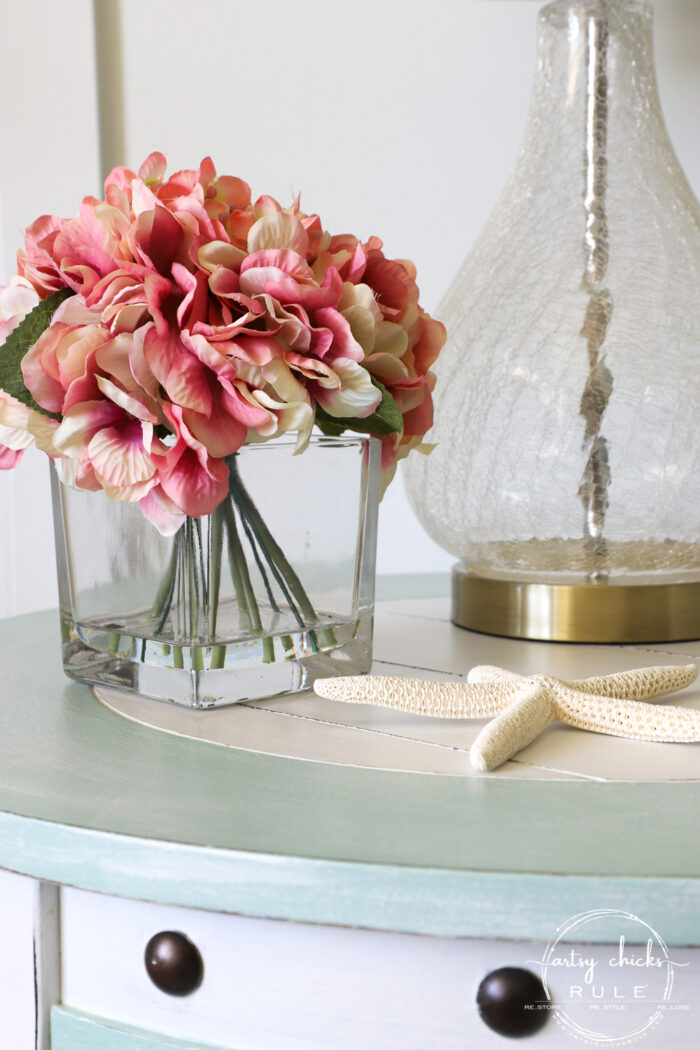 Nautical end table close up with pink flowers artsychicksrule.com