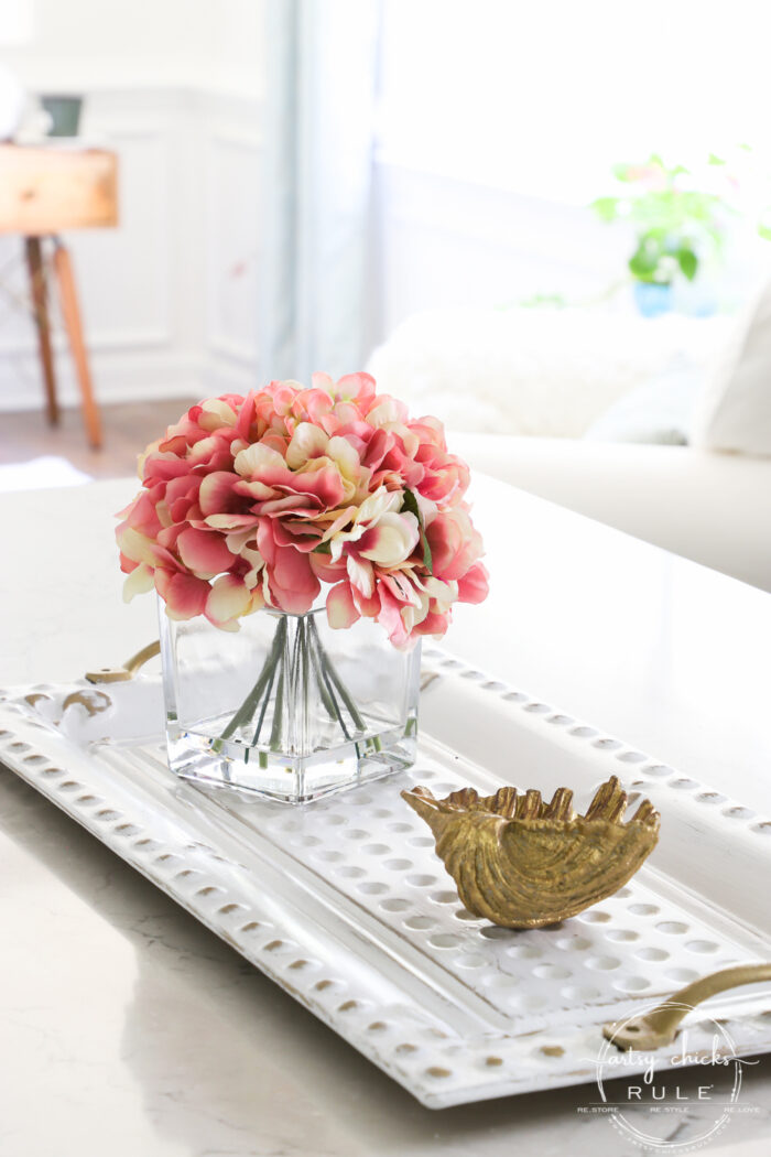 Pink flowers on white and gold tray with gold seashell artsychicksrule.com
