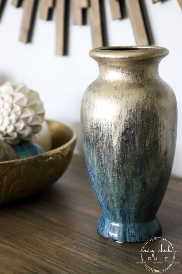 Thrifty find? Not the right color? Add a little paint and make it yours! This painted vase got a brand new look with a dash of gold paint. artsychicksrule.com #paintedvase #goldvase #blueandgold #craftymakeover #budgetdecor
