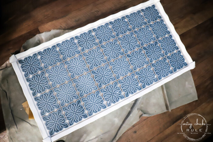 How To Tile A Table Top....easier than you think! Use this simple trick to tile all the things...furniture, decor and more! artsychicksrule.com #howtotile #tileatabletop #blueandwhitetile #furnituremakeover #paintedfurniture