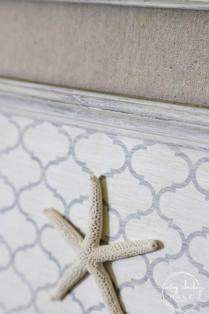 Shelf liner paper, paint and a few sea finds are all you need to transform a simple thrift store find into beautiful new starfish wall decor! artsychicksrule.com #starfishwalldecor #coastalwallart #coastaldecor #coastalhome