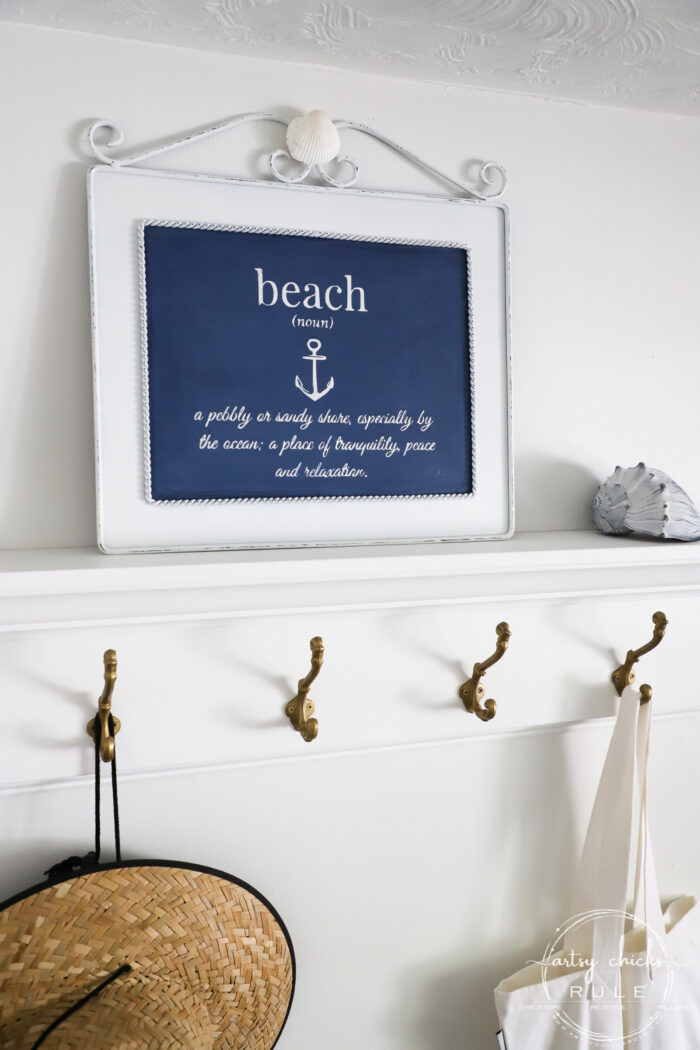 This $3 thrift store wall decor got an entirely new look with paint and a free printable! This fun metal beach sign is budget-friendly decor at its best! artsychicksrule.com #metalbeachsign #beachdecor #coastaldecor #freeprintable