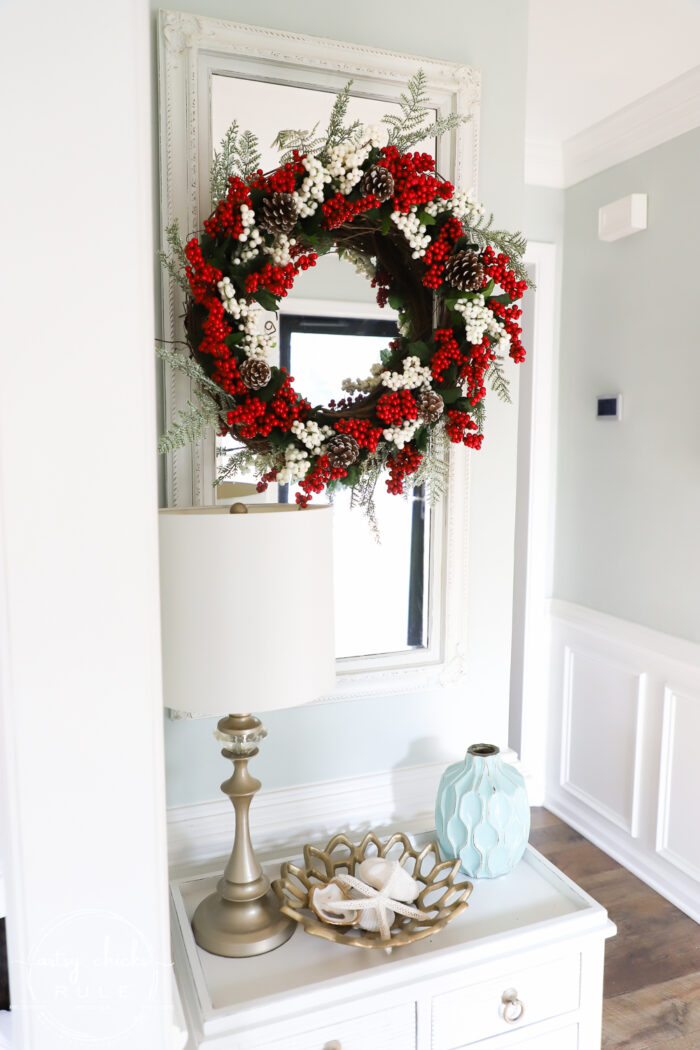 Fun and festive DIY red berry wreath made with items found at the Dollar Store! Budget friendly (and oh so simple) holiday decor! artsychicksrule.com #redberrywreath #diychristmaswreath #dollarstorecrafts #dollarstorewreath