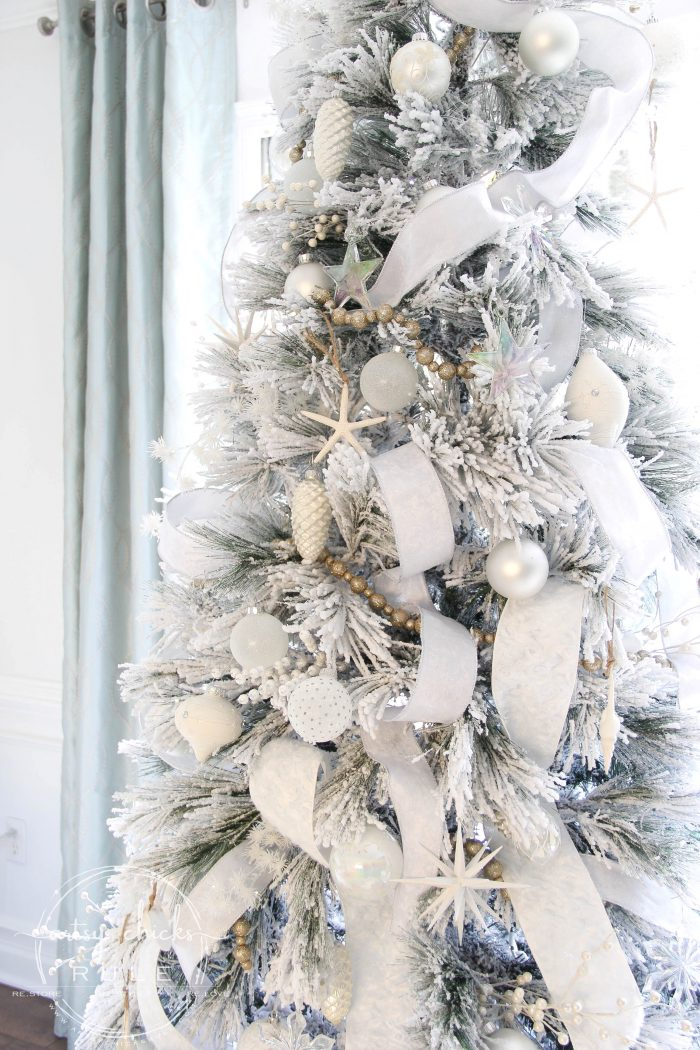 "Have you ever wondered how certain trees just look magically covered in snow?? Well, and just magical?? Today I'm sharing 5 ways to up your tree game...with ""snow"" so you can have a magical snow covered Christmas tree look too! artsychicksrule.com #snowcoveredtree #snowytreelook #flockedtree #snowfilledtree"