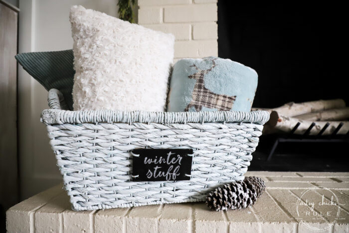$4 thrift store basket becomes the perfect winter basket for storing winter goodies! Also great for a gift basket with winter essentials! Paint is all you need! artsychicksrule.com #winterbasket #basketmakeover #thriftstorebasket #winterstuff