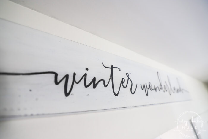 "Make your home winter ready (and cozy and warm!) with this ""winter wonderland"" sign! SO simple to make, anyone can do this. No special equipment needed! artsychicksrule.com #freeprintable #winterdecor #winterprojects #wintersign #winterwonderlandsign #winterstyle"