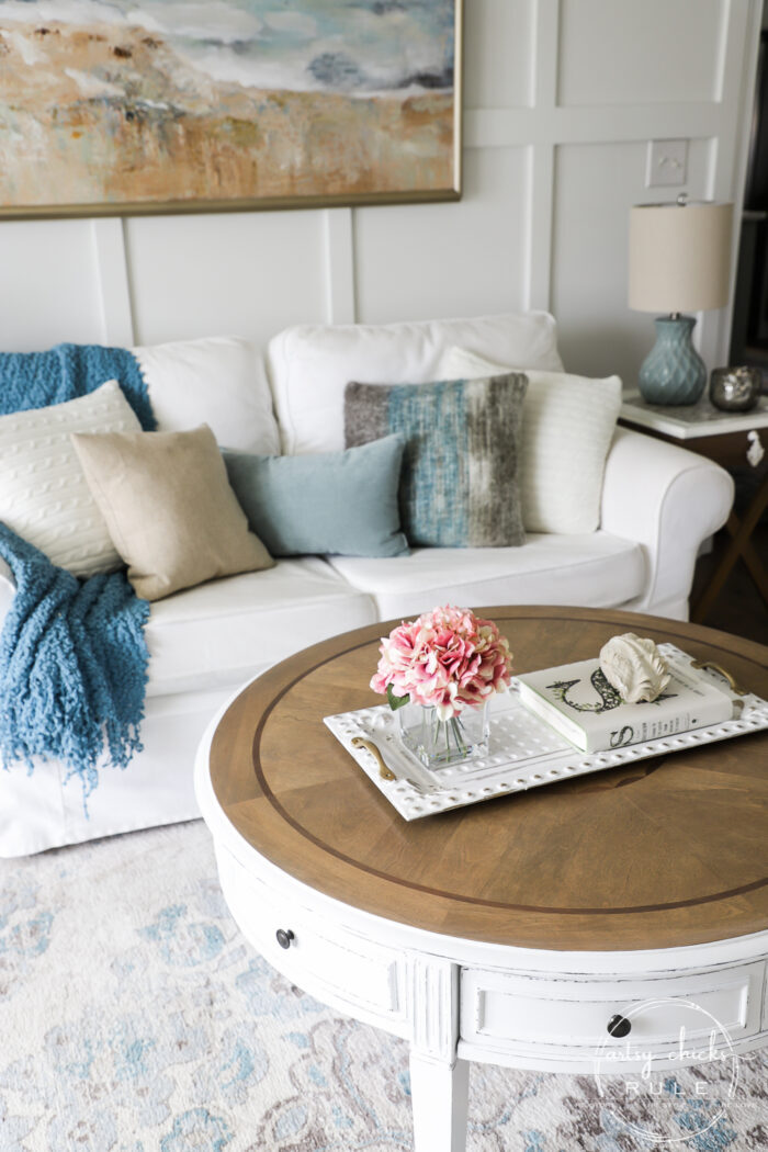 This $35 thrift store coffee table got a brand new, coastal style coffee table look ...with a little paint, stain and poly! Simple! artsychicksrule.com #coffeetablemakeover #coastalstyle #gelstain #chalkpaintedfurniture