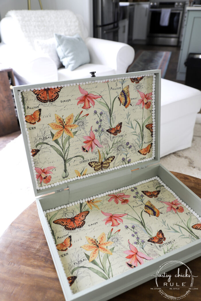 This old flatware box makeover uses pretty green paint, colorful new fabric and bird transfers for spring! Perfect for holding many things besides flatware! artsychicksrule.com #flatwarebox #silverwarebox #primadesigns #springprojects #fabricprojects