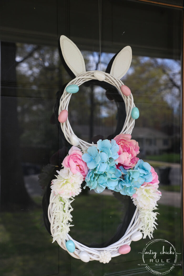 This adorable pink & blue bunny wreath is simple to throw together with just a few items! Perfect for spring and a fun project for kids! artsychicksrule.com #bunnywreath #pinkandbluewreath #springwreath #bunnyprojects