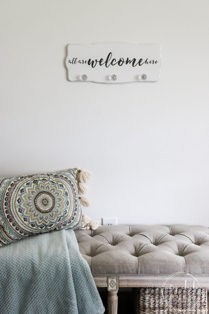 "Create a welcoming sign with this ""all are welcome here"" free graphic I'm sharing! Plus see how I transformed this $3 thrift store find. artsychicksrule.com #freeprintable #allarewelcomehere #welcomesign #silhouettecameo"