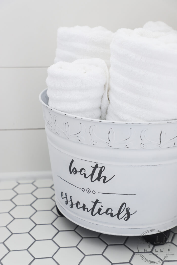 "This ""bath bucket"" started out as a $3 thrift store find! All it needed was a little paint, some feet and a brand new purpose! artsychicksrule.com #bathbucket #farmhousebath #farmhousedecor #farmhousebathdecor"