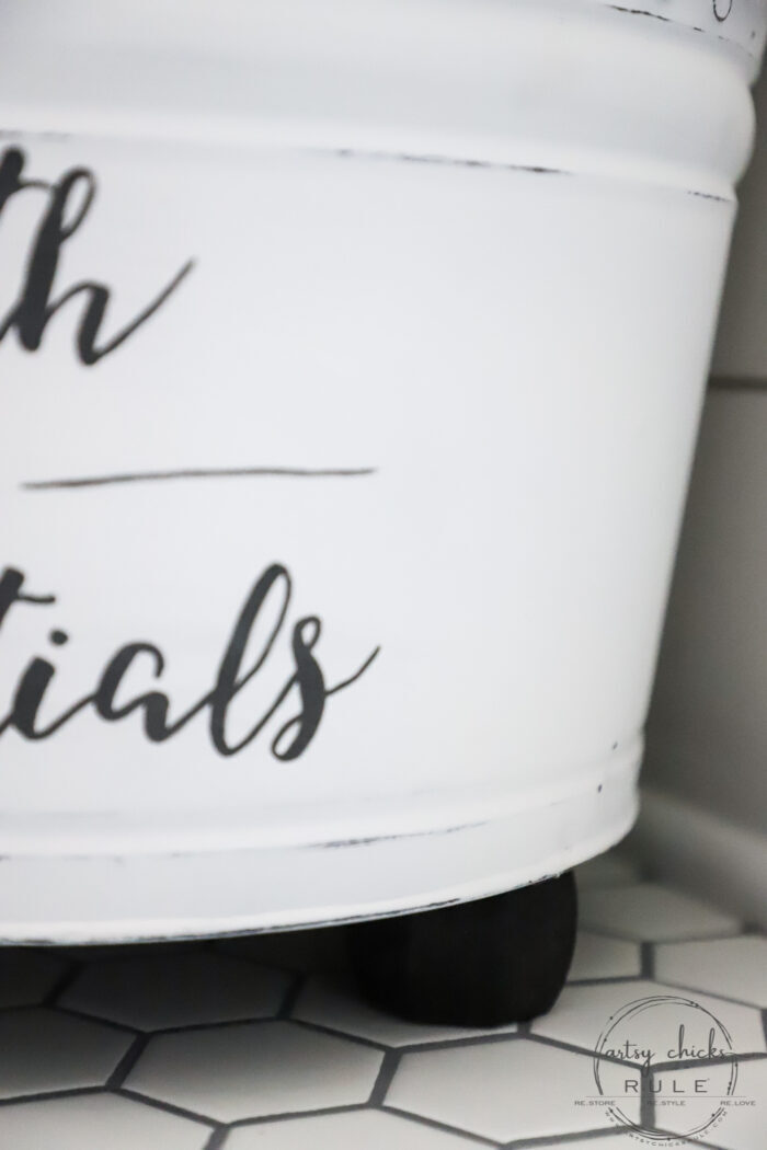 """This """"bath bucket"""" started out as a $3 thrift store find! All it needed was a little paint, some feet and a brand new purpose! artsychicksrule.com #bathbucket #farmhousebath #farmhousedecor #farmhousebathdecor"""