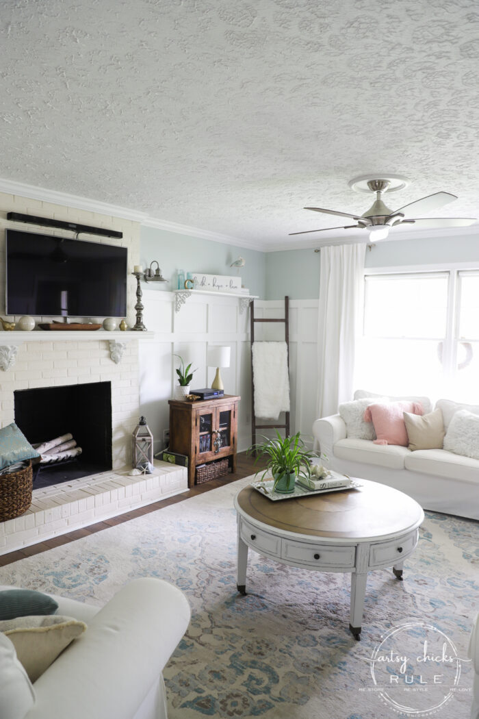 Round coffee table, coastal living room artsychicksrule.com