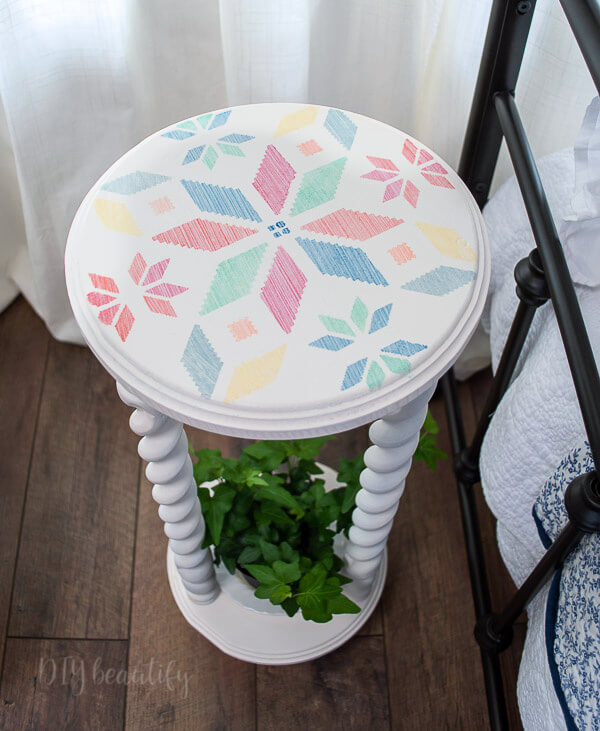 white plant stand stenciled top