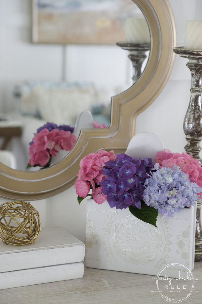 Spray paint, molding paste, and a stencil are all you need to create this sweet thrifted flower display! artsychicksrule.com #raisedstencil #thrifteddecorideas