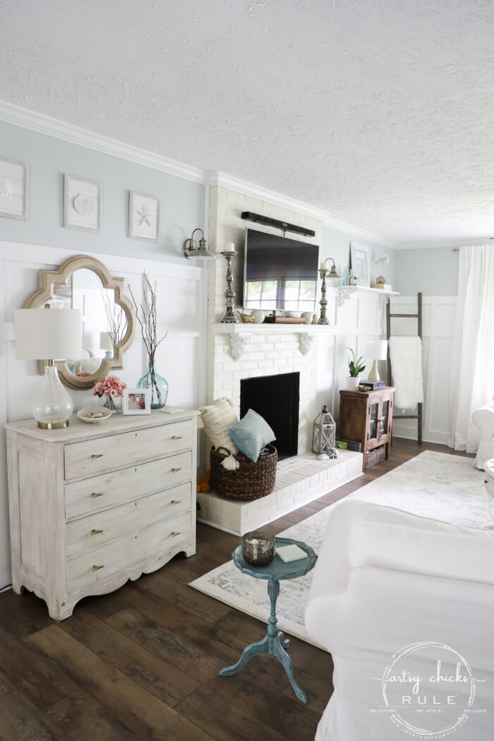 Coastal living room white stained chest brown laminate flooring