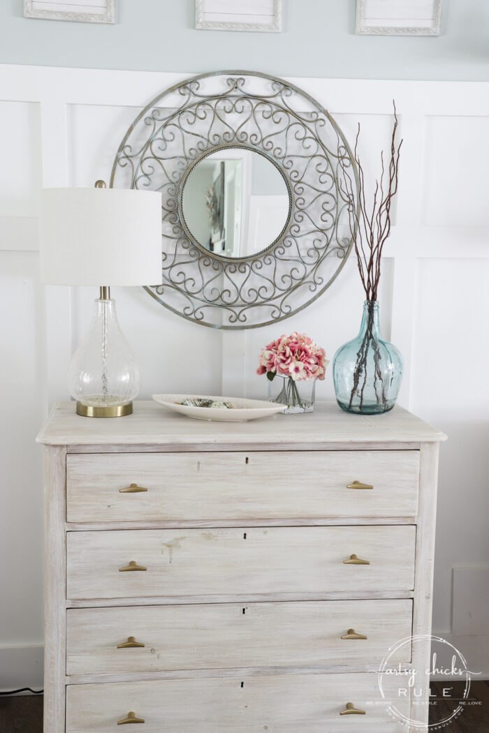 Sometimes all it needs is a little paint for a brand look and life. This simple metal mirror makeover is one anyone can do! artsychicksrule.com #metalmirror #scrollmirror
