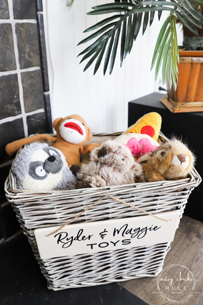 Create a dog toy basket simply out of an old thrift store basket...change it up with a little paint, a sweet sign, and a few toys! artsychicksrule.com #dogbasket #basketmakeover