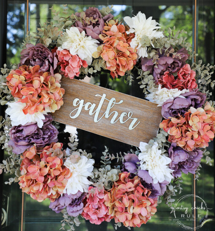purple, rust and cream wreath with gather sign in the middle