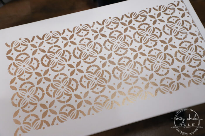 Give any old coffee table a glam new look with a gold stencil! From blah to beautiful with a little paint! artsychicksrule.com #stenciledprojects #stencilideas
