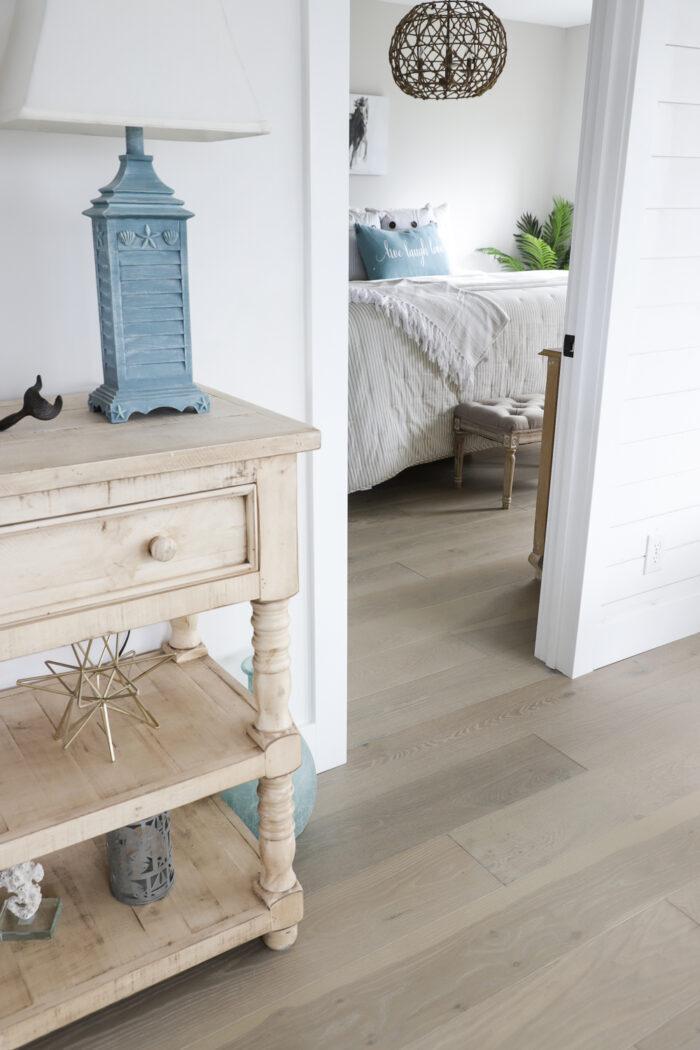 white walls blue lamp wood floor beach house