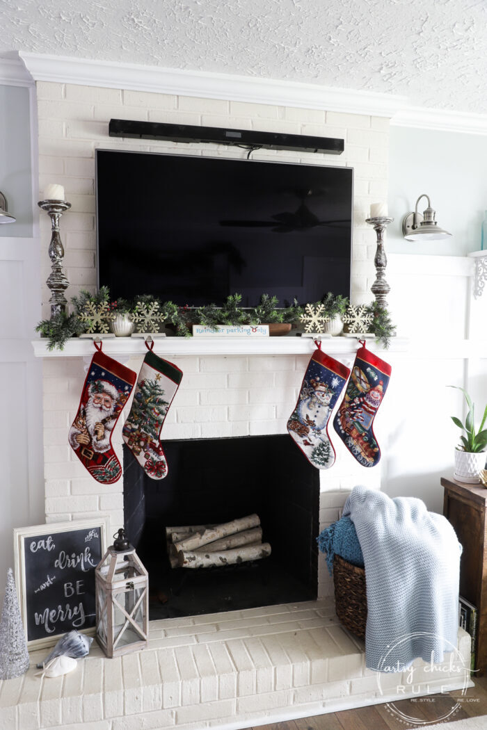 Create a cozy Christmas living room (and home) with sweet, sentimental touches, pops of red, cozy throws, and pillows!