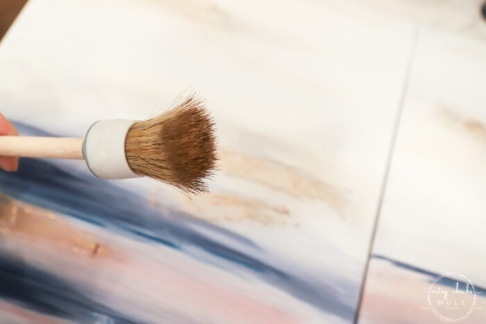 Showing the end of the bristle brush with gold paint