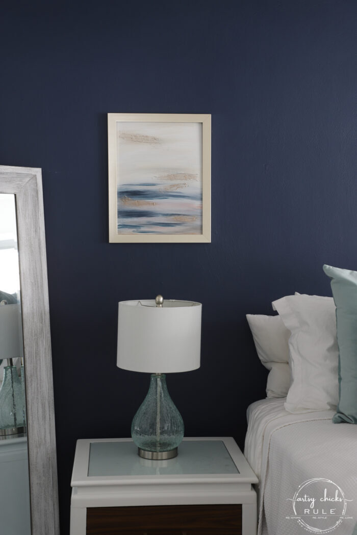 Abstract art on navy wall