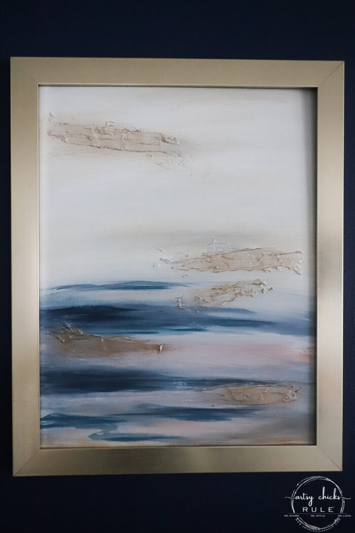 straight on close up of abstract beach art and gold frame left side