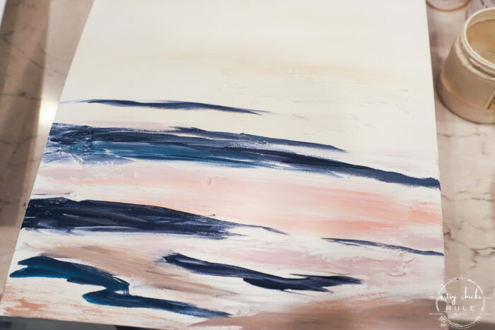 first step when painting abstract beach art with navy, pink and brown colors